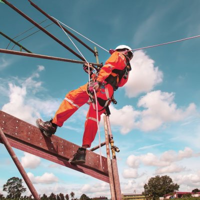 Construction worker with a safety harness while working from a height